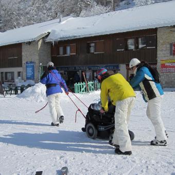 rolstoel sneeuw ski